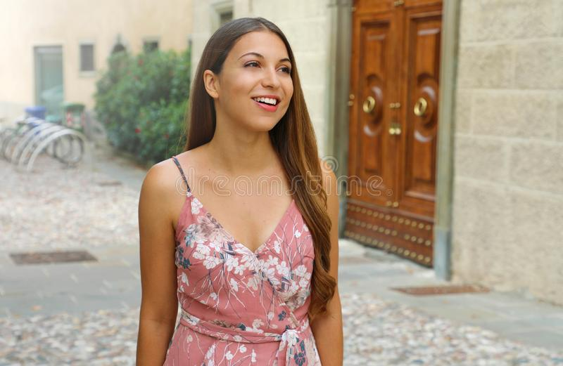 Young beautiful woman walking the streets of an Italian town royalty free stock images