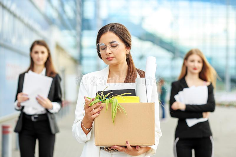 A young beautiful woman was fired from her job. The end of a career. Concept for business, unemployment, labor exchange and royalty free stock photo