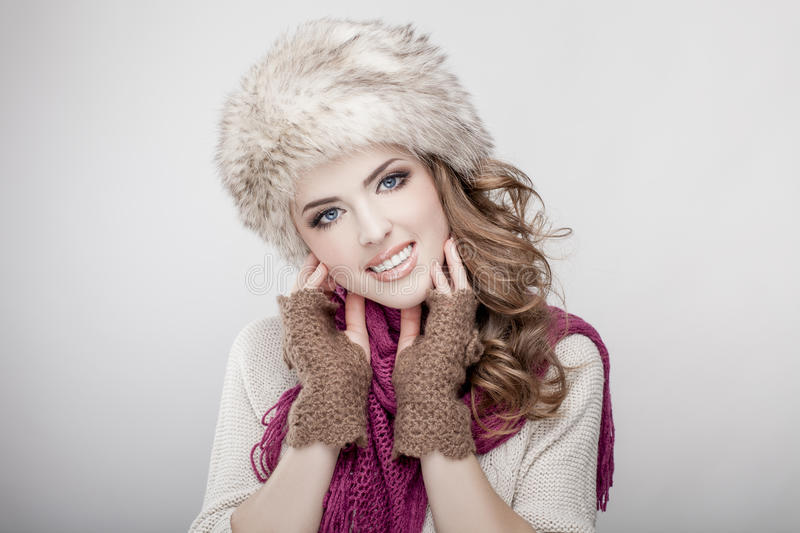 Young beautiful woman wearing fur hat and scarf stock image