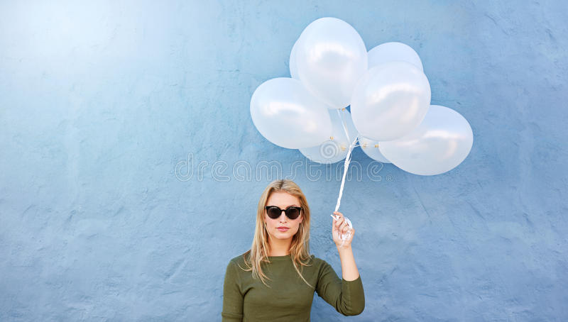 Young beautiful woman with white balloons stock images