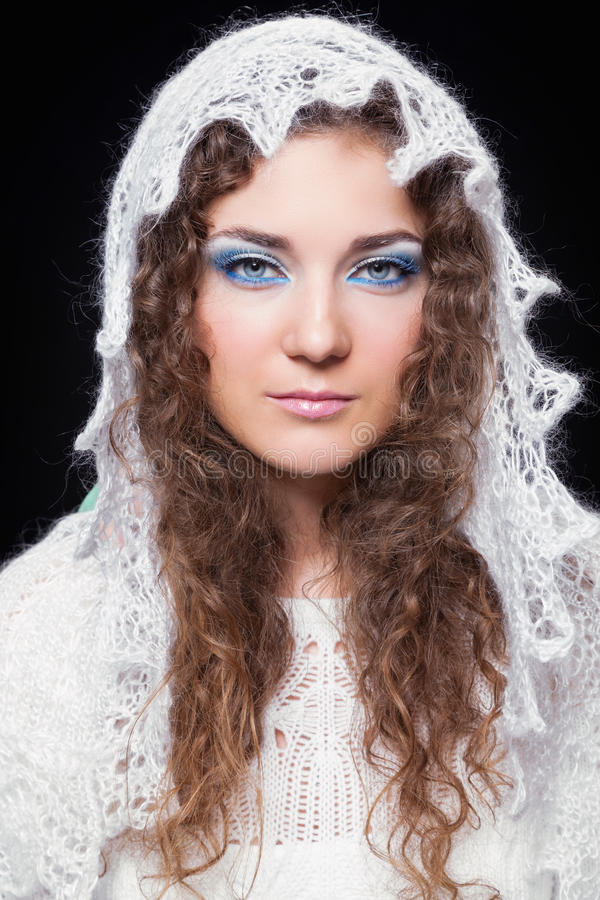 Young beautiful woman in white knitted openwork scarf stock image