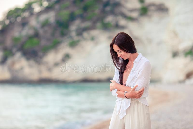 Young beautiful woman on white tropical beach. stock photos