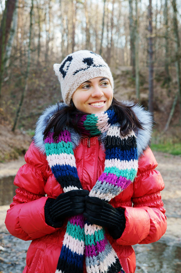 Young beautiful woman in winter overclothes