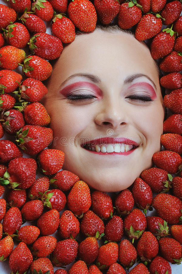Free Young Beautiful Woman With White Teeth Closing Her Eyes On Strawberries Background Stock Photos - 29227253