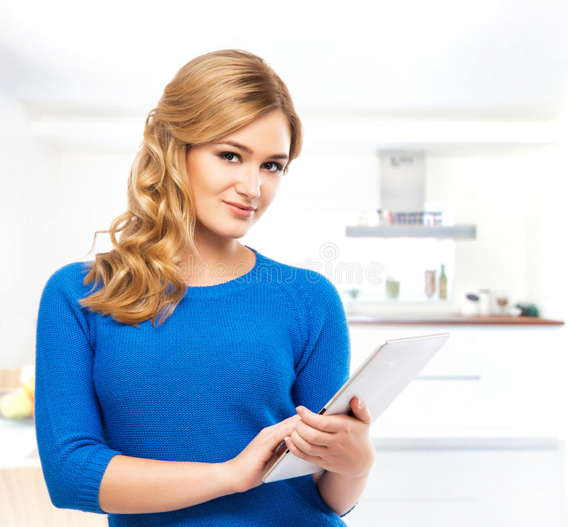Young and beautiful woman woman with a tablet royalty free stock images