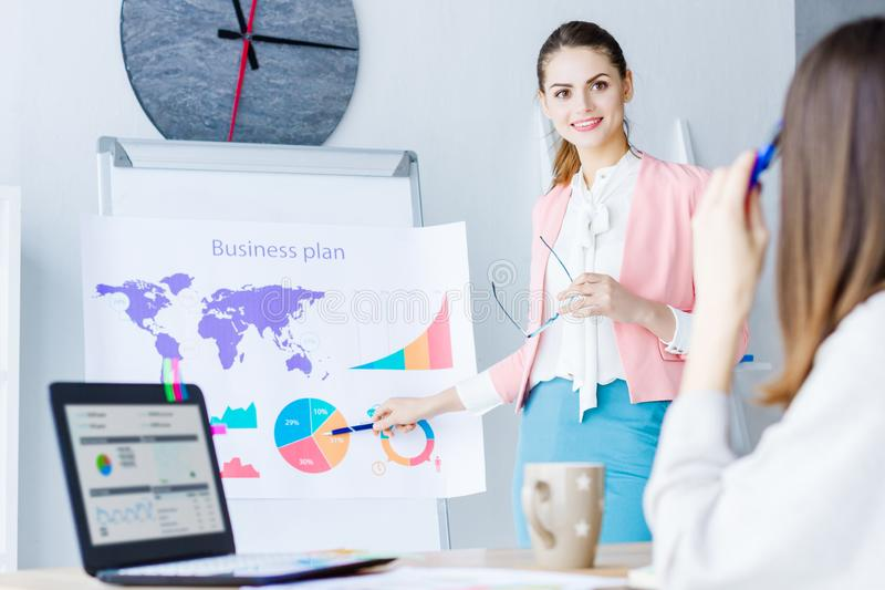 Confident business woman on business meeting at office royalty free stock photos