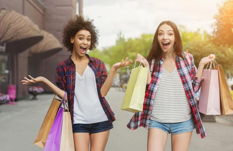 Young beautiful women enjoy in shopping together royalty free stock photography
