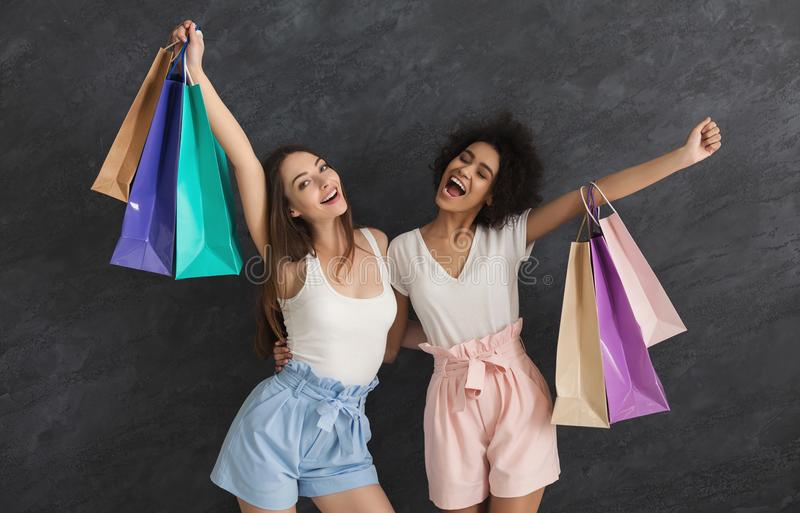 Young beautiful women enjoy shopping together royalty free stock photography