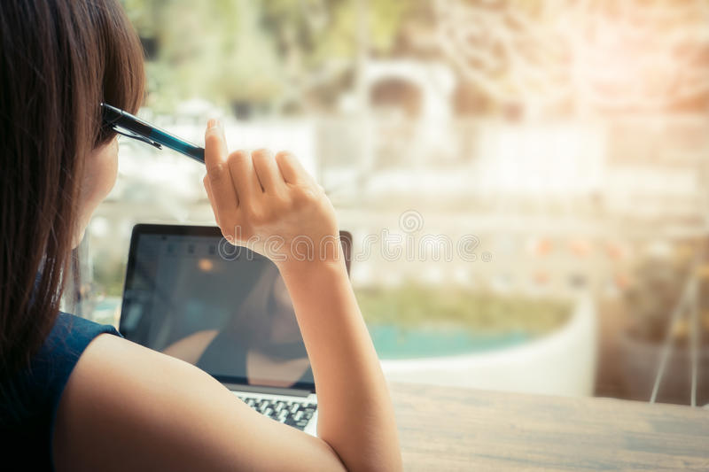 Young beautiful women sitting and thinking about her business be stock photo