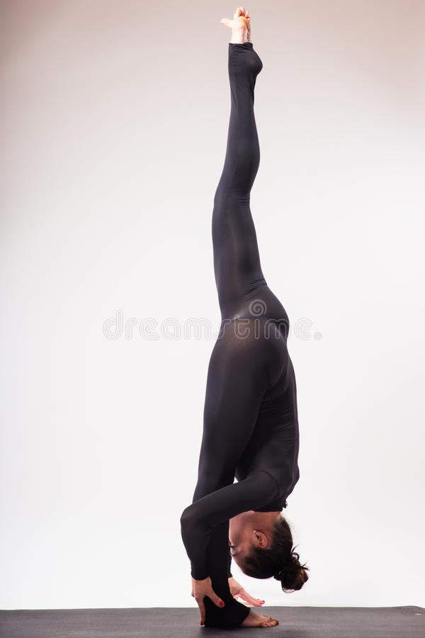 Young beautiful yoga female posing on a studio background royalty free stock photography