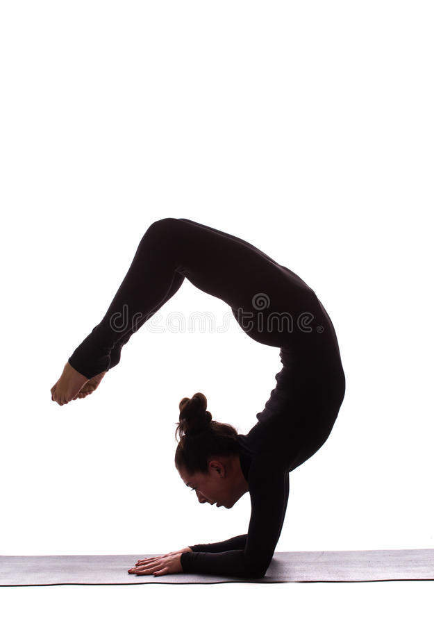 Young beautiful yoga female posing on a studio background royalty free stock images