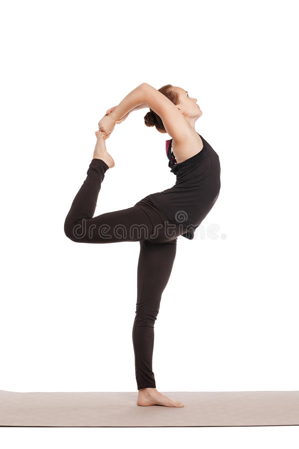 Young beautiful yoga posing isolated on white royalty free stock photo