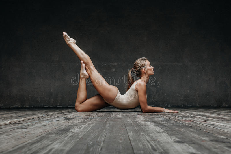Young beautiful yoga posing in studio stock photos