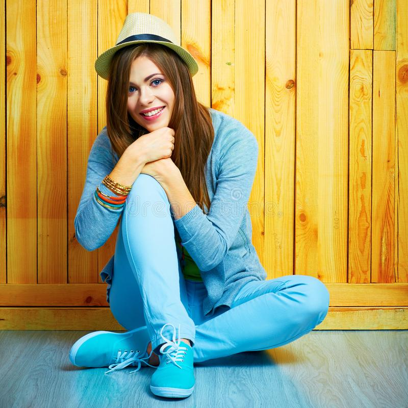 Young beautifull woman in hipster youth style sitting on a floo royalty free stock photography