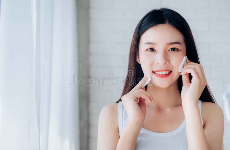 Young Beauty Asian Woman Cleaning Face with Cotton royalty free stock image