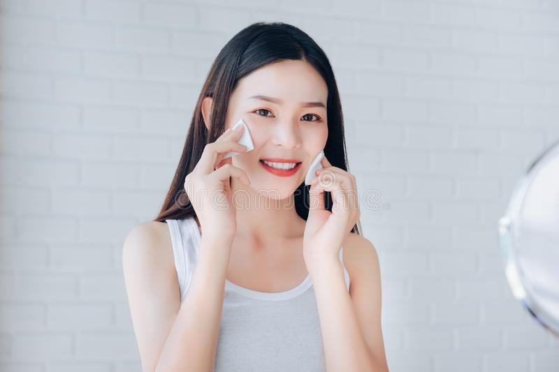 Young Beauty Asian Woman Cleaning Face with Cotton Clear Face stock images