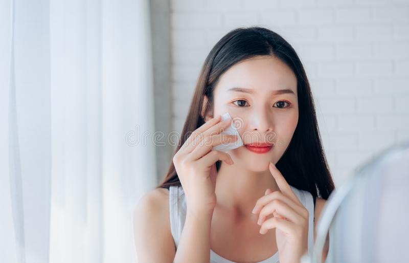 Young Beauty Asian Woman Cleaning Face with Cotton stock image
