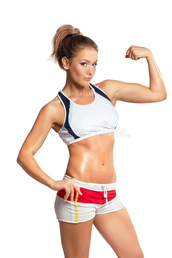 Young beauty fitness woman showing her muscles. Isolated on white stock photos