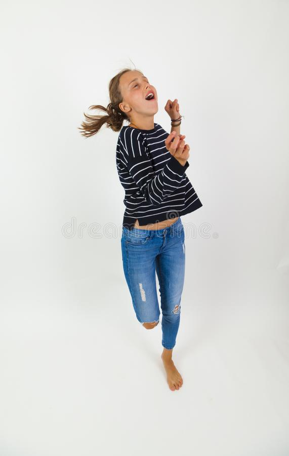 Girl flying in jump with brown hair. Young beauty girl flying in jump with brown hair royalty free stock image