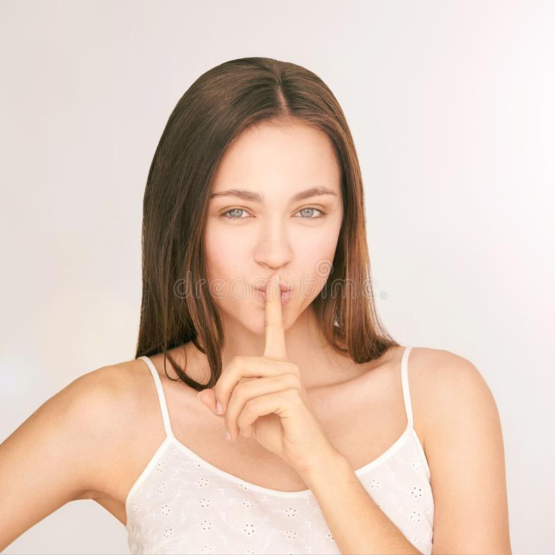 Young beauty girl. Shh concept. Silent gesture royalty free stock photography