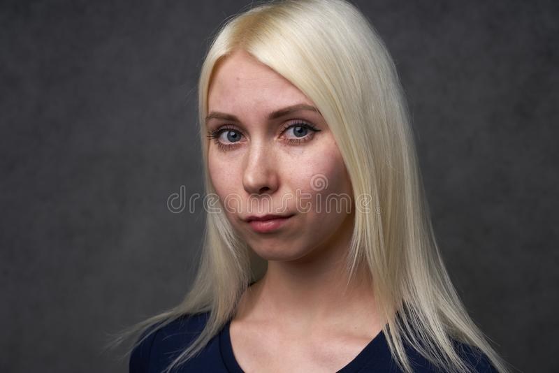Young beauty girl in white clothes on the gray backround. Portrait stock photos