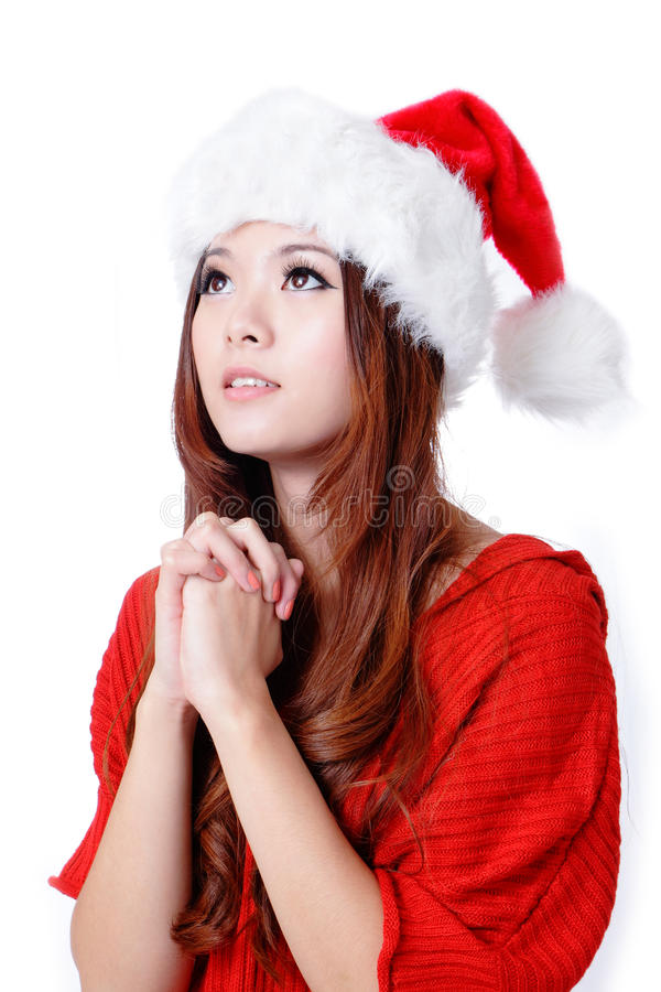Young Beauty Girl wish with christmas hat stock photo