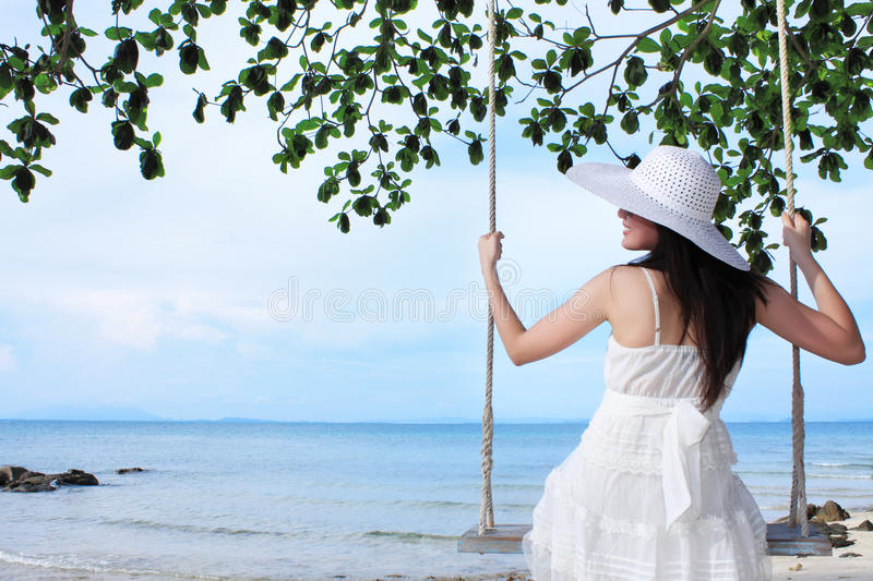 Young Beauty Lady Sitting On Rope Swings Royalty Free Stock Photo