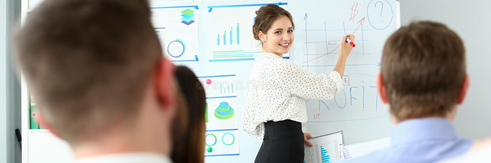 Young handsome teacher man in suit with. Young beauty teacher women in class room workgroup seminar board with chart coaching background. Lecturer applicants royalty free stock photos