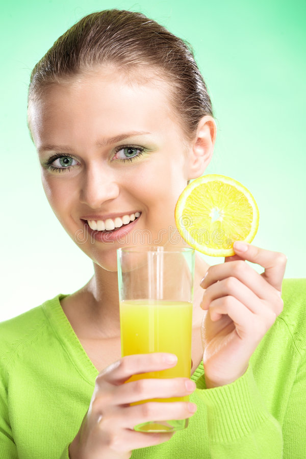 Young beauty woman with apple. Young beauty woman with fruit juices on green background stock images
