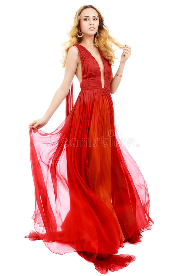 Young beauty woman in fluttering red dress. White background stock photo