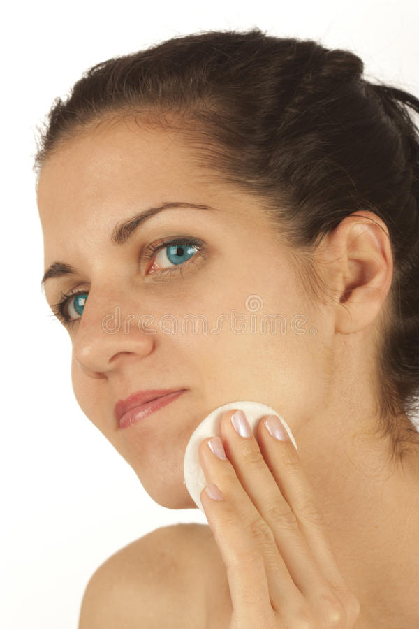 Young beauty woman washing her face royalty free stock photos