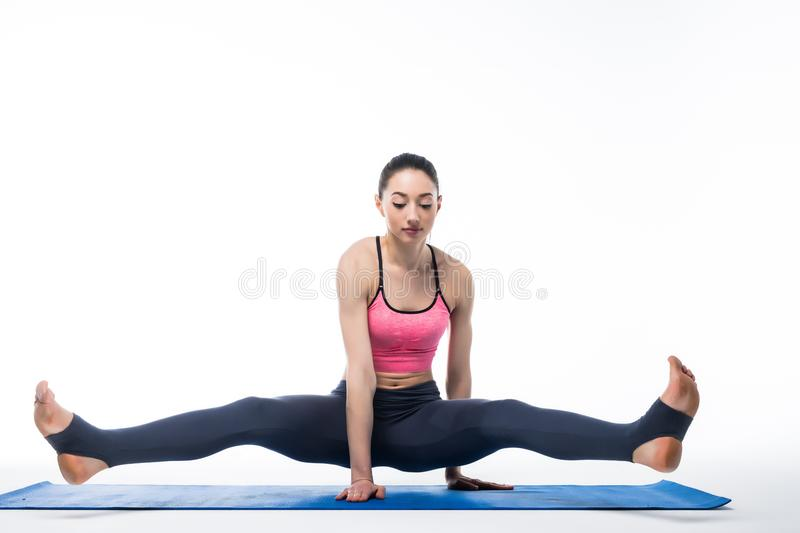Young beauty Woman working yoga exercise isolated on white background royalty free stock photography