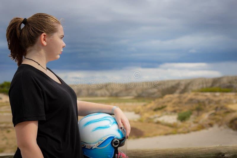 Young biker girl with helmet stock image