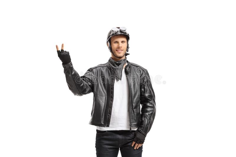 Young biker making a peace gesture stock photos