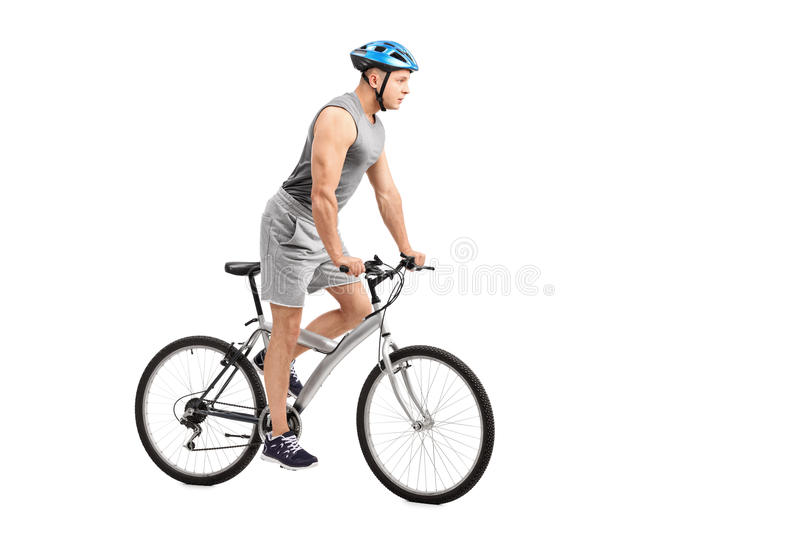 Young biker riding a bicycle royalty free stock photos