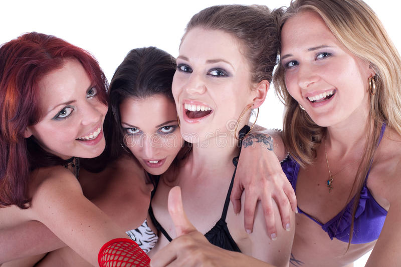 Young bikini party. Young group of four models with bikini. They are all partying and having fun stock photo