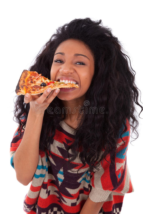 Young black african american teenage girl eating a slice of pizza - african people royalty free stock photography