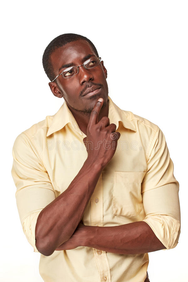 Young black african man thinking and reminiscing royalty free stock photography