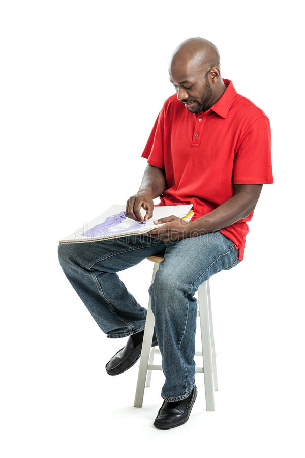 Young black artist drawing a picture stock photo