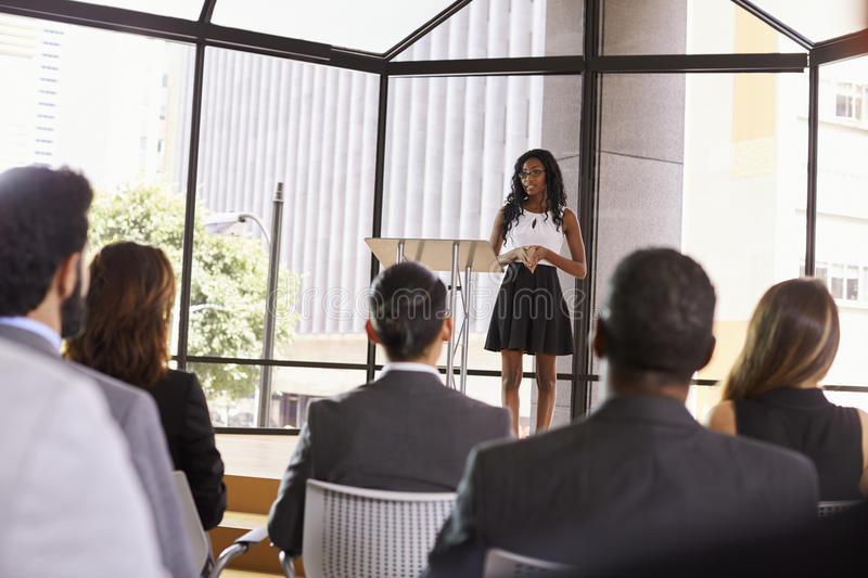 Young black businesswoman presenting seminar to an audience stock photos