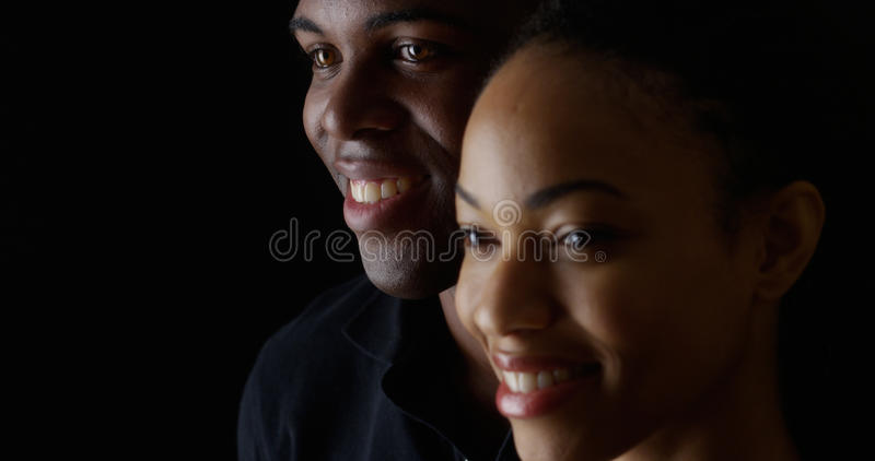 Young black couple smiling royalty free stock photo