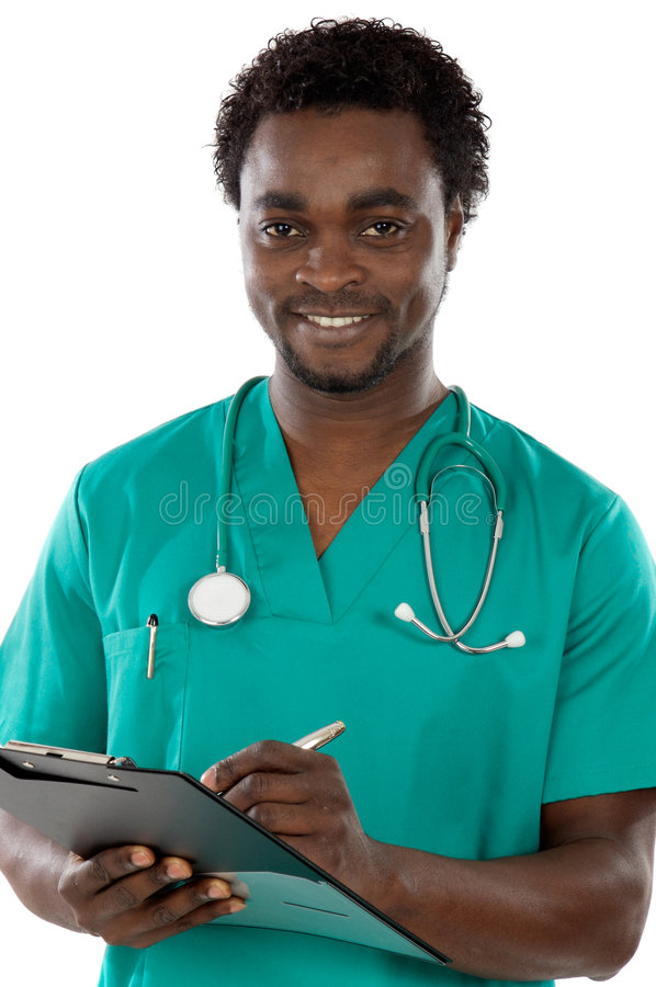 Young black doctor writing stock photo