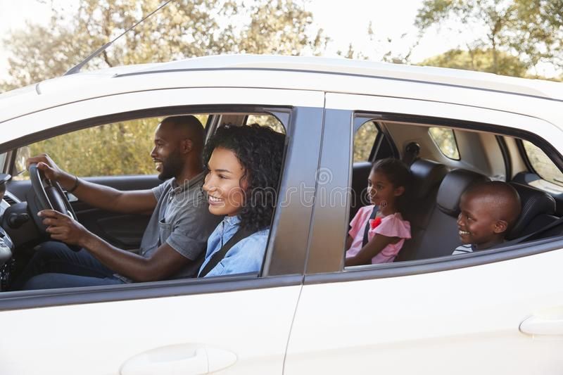 Young black family in a car smile on the road trip stock image