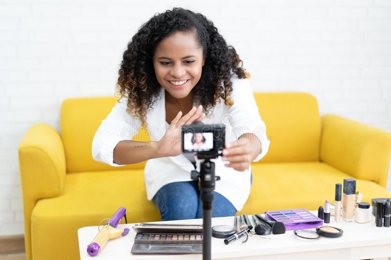 Young black girl female make up vlogger setting camera video wi royalty free stock image