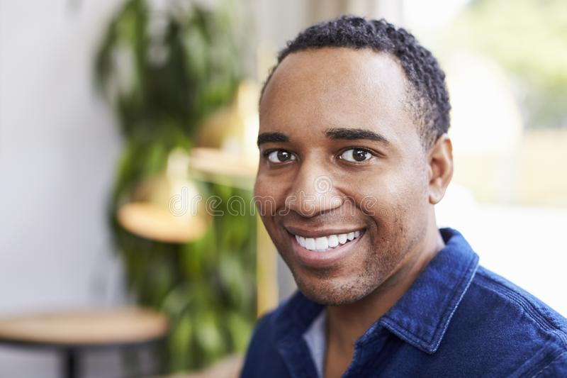 Young black male business owner at a coffee shop, portrait stock photography
