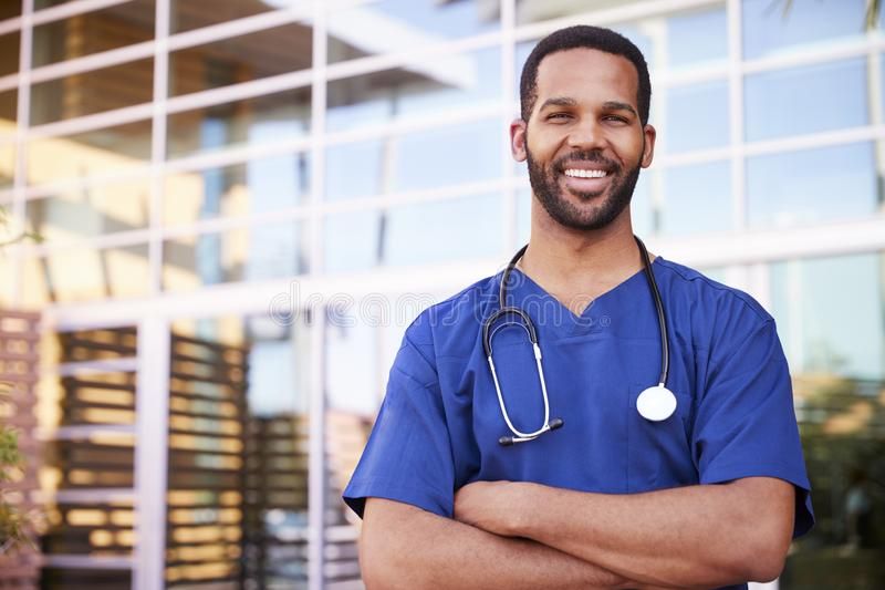 Young black male healthcare worker smiling outside, portrait stock images