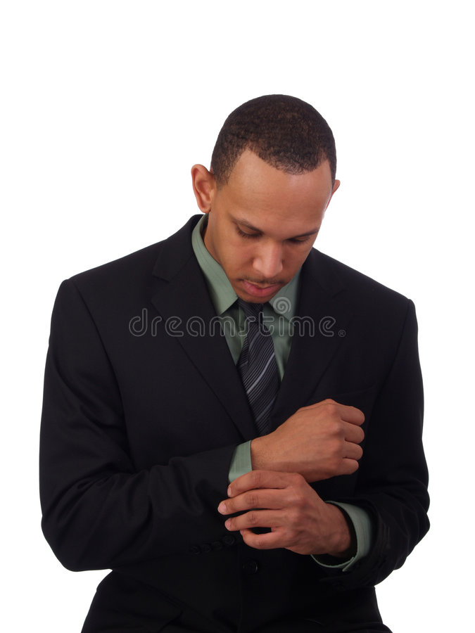 Young black man in business suit looking down royalty free stock images