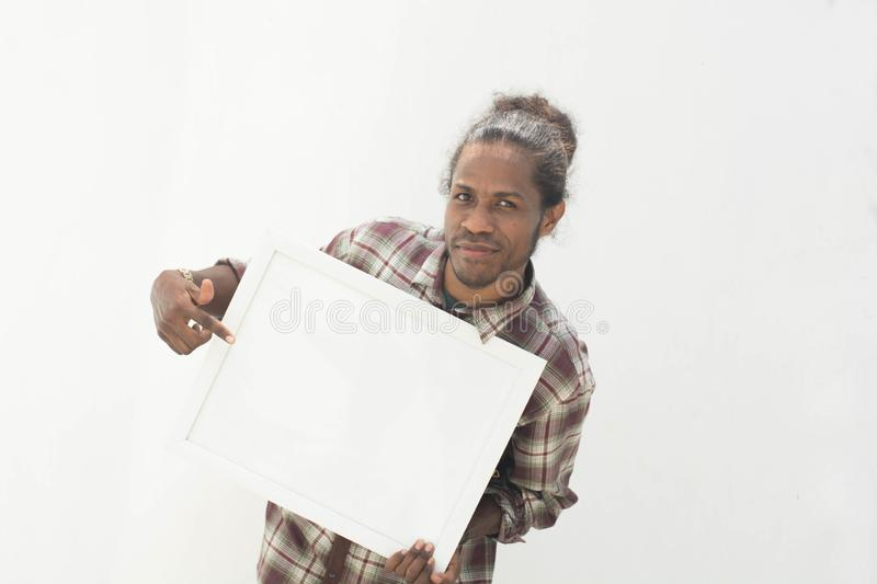 A young black man holding white board with isolated background in white royalty free stock photography