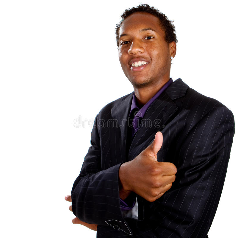 Young black and successfull. Young black businessman with suit isolated over white background. He is giving a thumbs up sign stock images