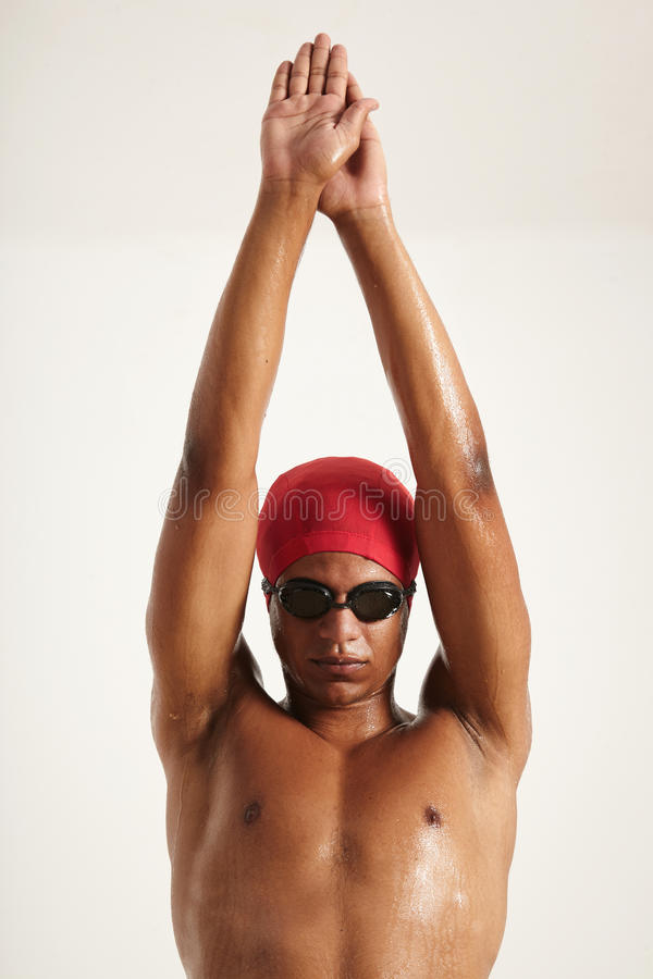 Young black swimmer raising hands up to dive stock photos